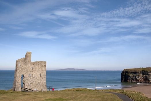 a beautiful path with tourist walking to Ballybunion beach and castle