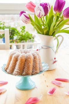 Sponge cake and tulips