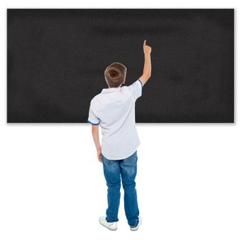 Rear view of a student pointing on a blackboard