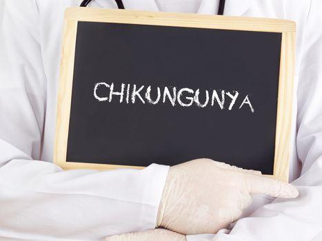 Doctor shows information on blackboard: Chikungunya