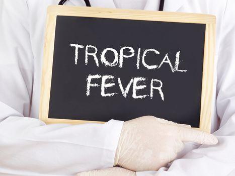 Doctor shows information on blackboard: Tropical fever