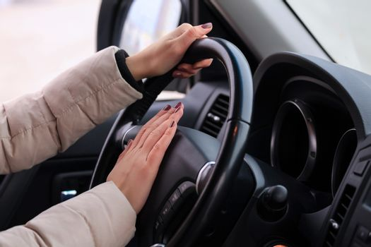 Woman presses on horn button