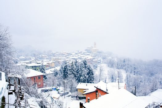 View of Town covered by snow, Italy