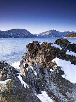 Winter dawn at Lake Teletskoye. Altai Republic, Russia