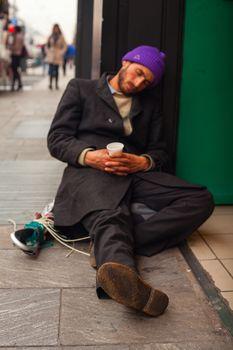 MILAN, ITALY - NOVEMBER, 24: Homeless sleeping in the floor of the street on November 24, 2014
