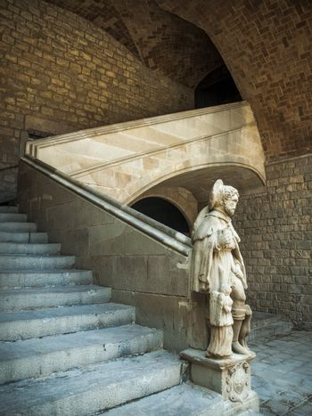The stair with the sculpture in the inner yard. Barcelona, Spain