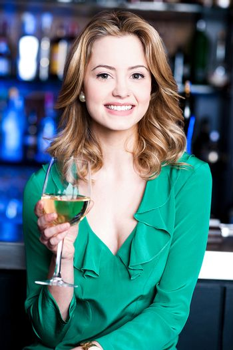 Pretty woman with aperitif.