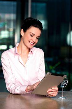 Woman selecting menu on digital tablet