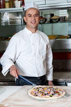 Chef with prepared pizza dough