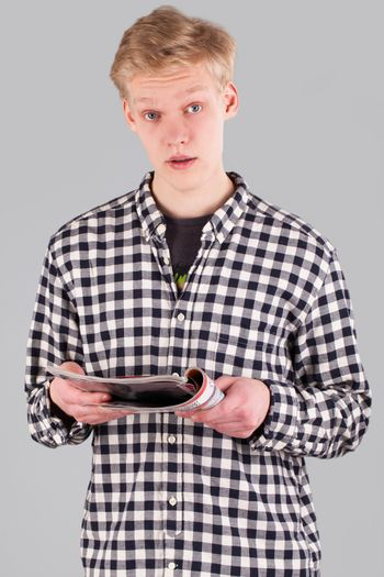 Young handsome guy with journal