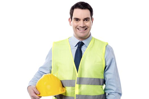 Smiling engineer with safety helmet