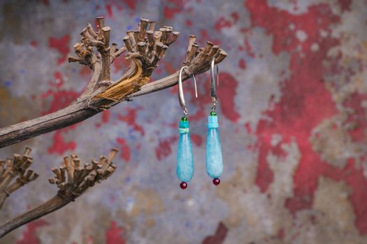 Close up of precious stones earrings, manufactured by Ornella Salamone