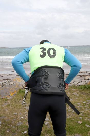 windsurfer getting ready on the beach in the maharees county kerry ireland