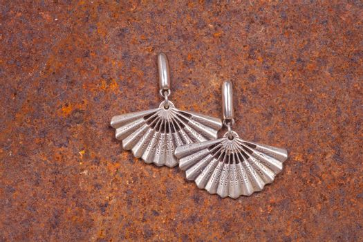 Close up of silver earrings, manufactured by Ornella Salamone