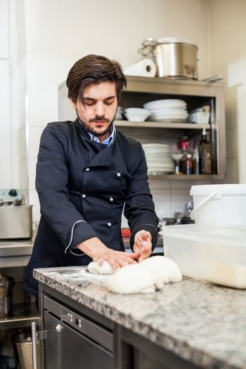 Chef tossing dough while making pastries