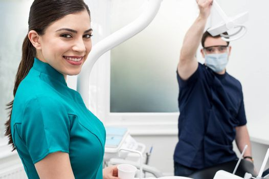 Female dental assistant smiling at the camera
