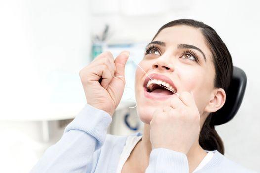 I am floss my teeth regularly.