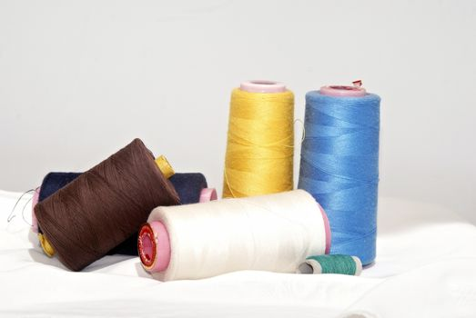spool of colored thread to sew