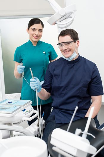 Male dentist with female assistant at dental clinic