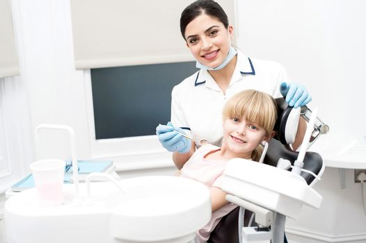 Girl child and dental hygienist at dental clinic