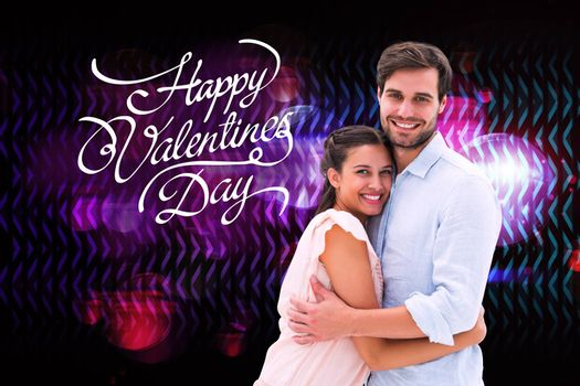 Attractive young couple hugging and smiling at camera against digitally generated cool disco design
