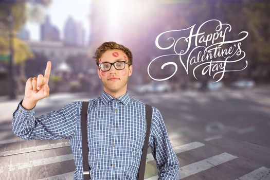 Geeky hipster covered in kisses against blurred new york street