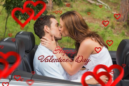 Beautiful couple kissing in back seat against cute valentines message