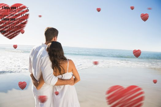 Content couple looking at the sea against valentines day pattern