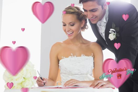 Happy young couple signing wedding register against cute valentines message