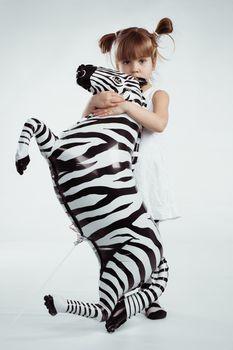 Child with zebra