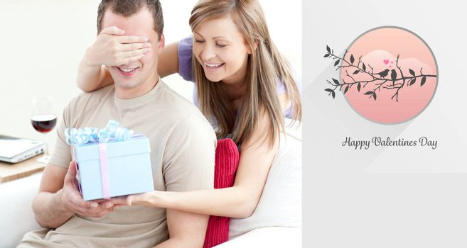 Smiling woman giving a present to her boyfriend against love birds