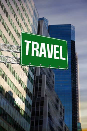 The word travel and green billboard sign against low angle view of skyscrapers
