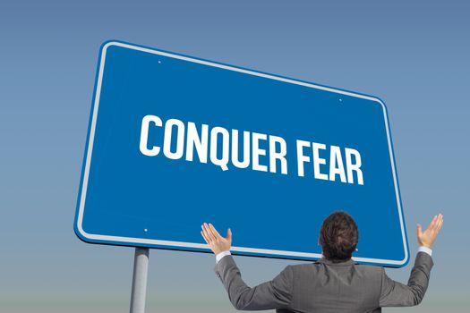 Conquer fear against blue sky