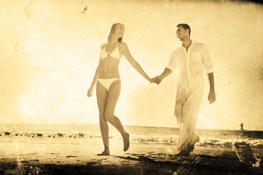 Pretty blonde walking away from man holding her hand against grey background