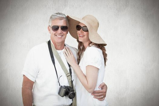 Vacationing couple against white background