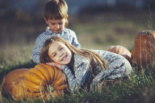 Cute kids having fun at countryside at halloween
