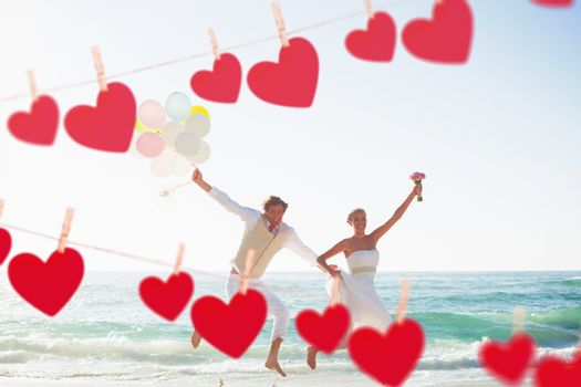 Hearts hanging on a line against newlyweds having fun holding balloons