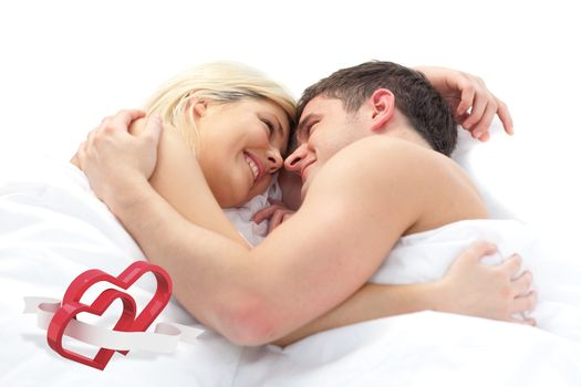 loving Couple relaxing on bed  against linking hearts