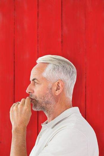 Composite image of man staying silent with finger on lips