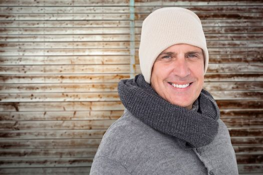 Composite image of casual man in warm clothing