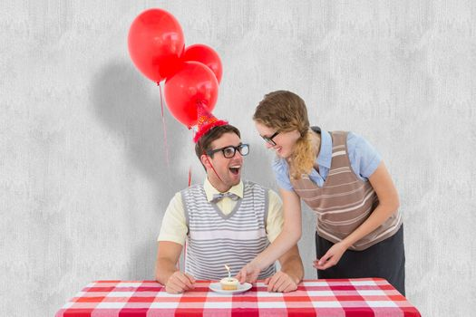 Geeky hipster couple celebrating his birthday  against white background