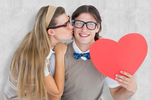 Smiling geeky hipster and his girlfriend  against white background