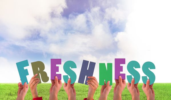 Composite image of hands holding up freshness