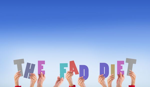 Composite image of hands holding up the fad diet