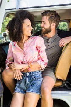 Hipster couple in camper van