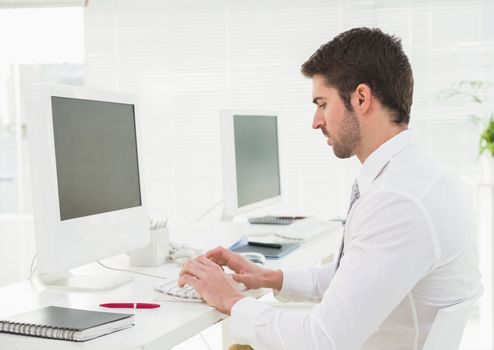 Classy businessman typing on keyboard