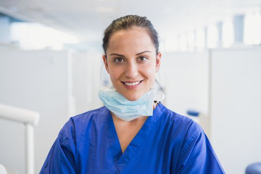 Portrait of a smiling dentist in dental clinic