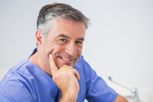 Portrait of a cheerful dentist in dental clinic