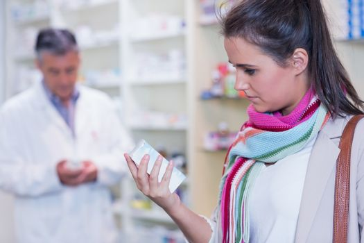 Customer holding a drug box