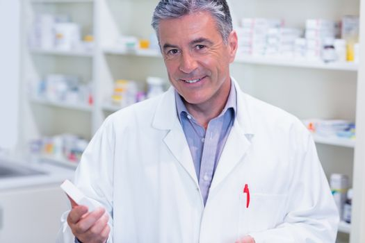 Portrait of a smiling pharmacist wearing lab coat